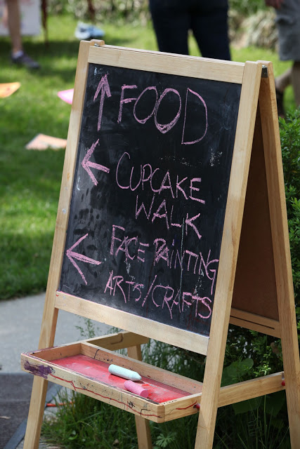 sign describing the food and arts table at the truck touch, aDC area family event