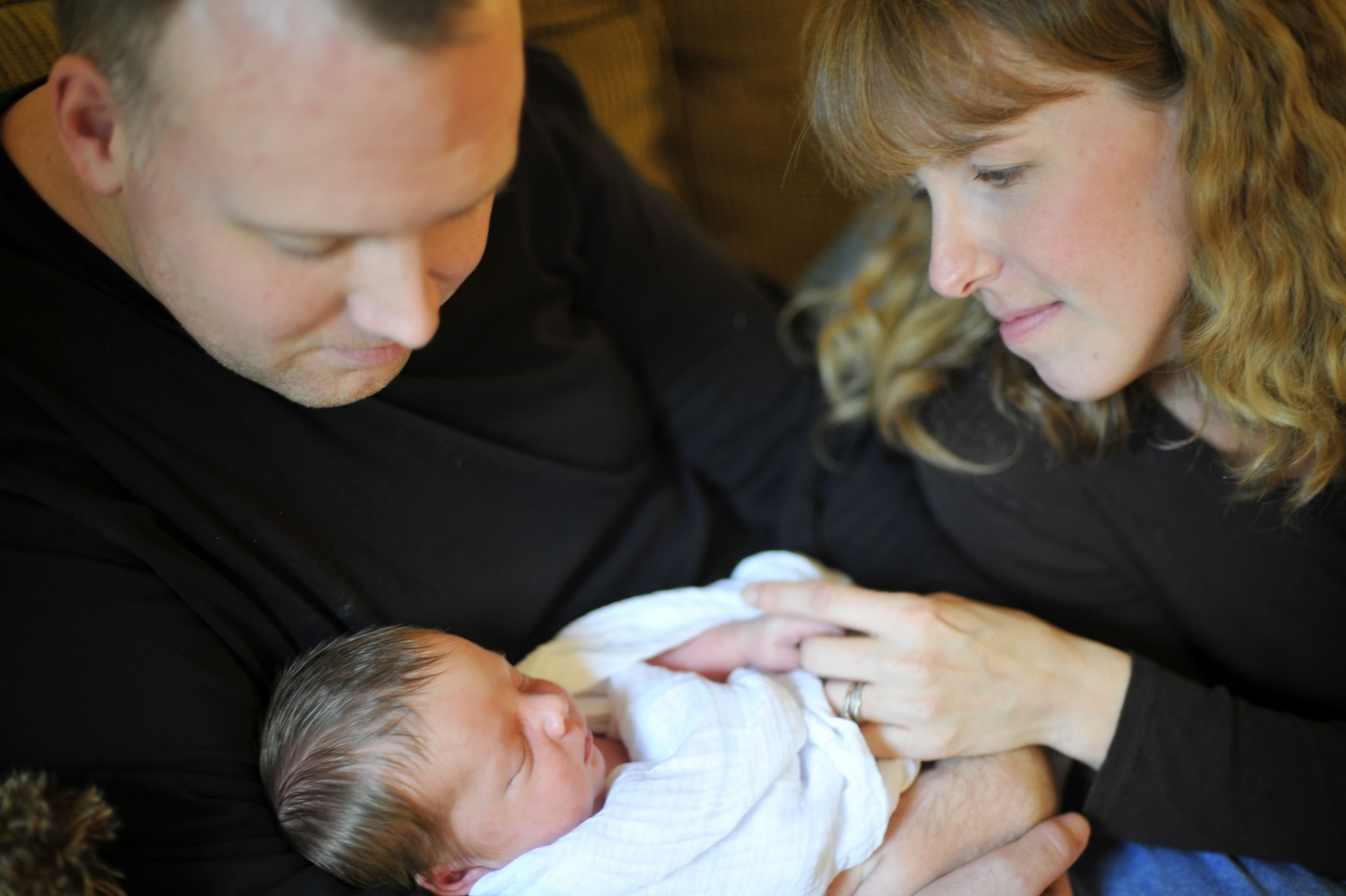 Jenny Corbett, certified provider of placenta encapsulation in Silver Spring, with her husband and newborn son.
